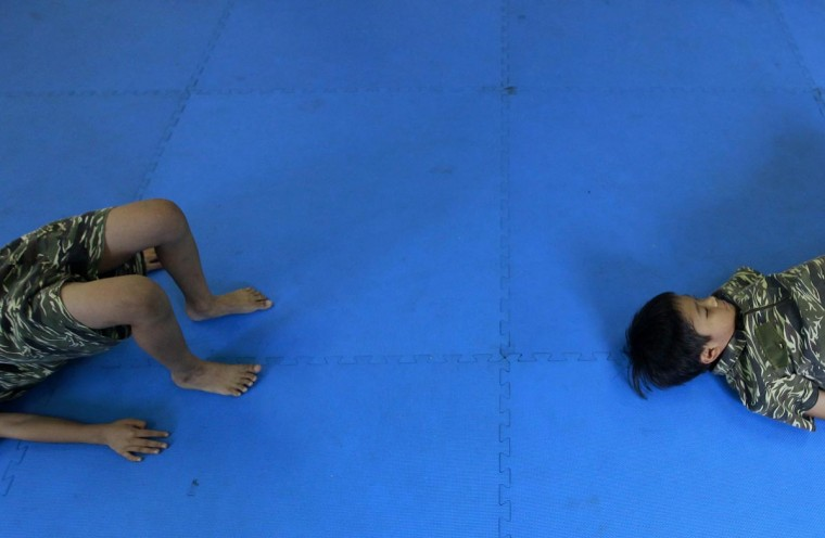 Kids attend a physical training session that combines marine drills and gymnastics in a kindergarten class in Taichung, central Taiwan, July 15, 2013. (Pichi Chuang/Reuters)