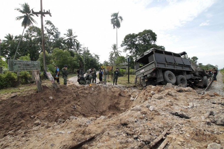 Thai security personnel inspect the wreckage of a military truck after a bomb attack by suspected Muslim militants on a roadside near a railway in Yala province, south of Bangkok. Eight soldiers were injured in the explosion on their way to providing security for teachers traveling to a school, police said. (Surapan Boonthanom/Reuters)