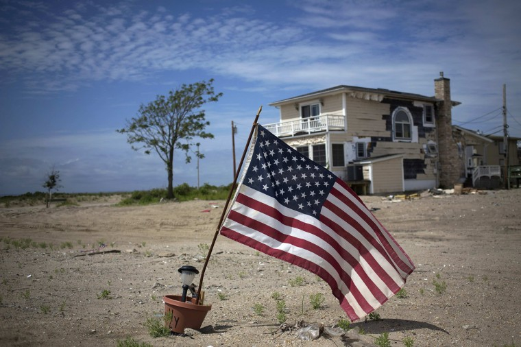 An American flag is seen outside a home in the Hurricane Sandy devastated area of the Breezy Point section of the Queens borough of New York. (Shannon Stapleton/Reuters)