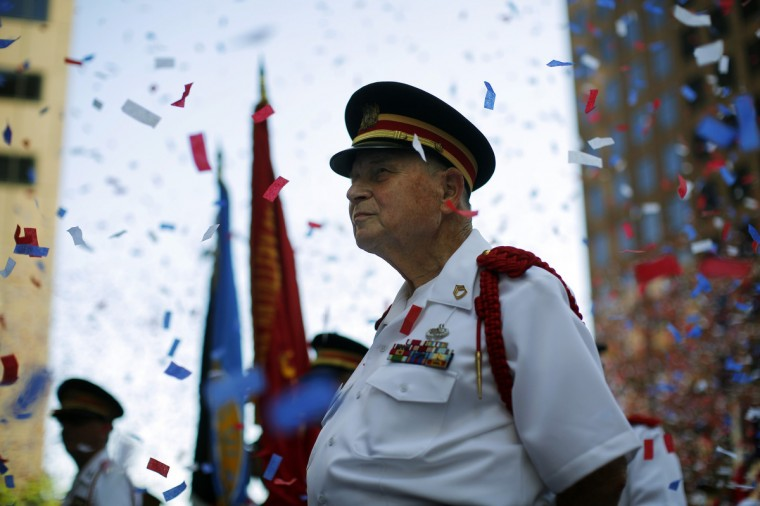A member of the Ancient and Honorable Artillery Company stands amid confetti following a reading the United States Declaration of Independence, part Fourth of July Independence Day celebrations, in Boston, Massachusetts. (Brian Snyder/Reuters)