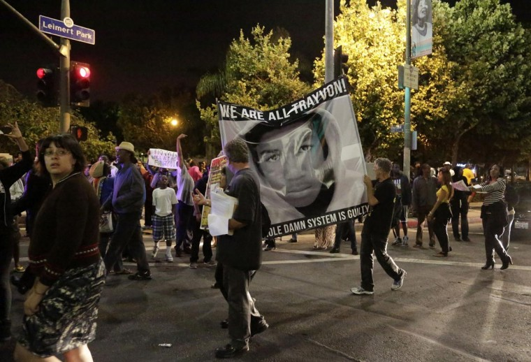 Protesters march in the Leimert Park area of Los Angeles, California, following the George Zimmerman verdict, July 13, 2013.(Jason Redmond/Reuters)