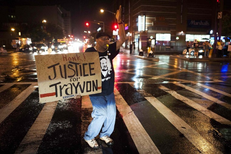 Will Reese holds a protest sign in response to the acquittal of George Zimmerman in the Trayvon Martin trial, in the Harlem neighborhood of New York, July 14, 2013. (Keith Bedford/Reuters)