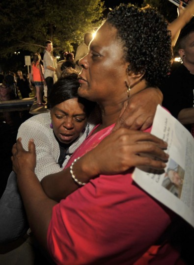 Diane Whitaker (R) comforts Carmen Taylor as they react to the verdict outside Seminole County Court where George Zimmerman was found not guilty on second-degree murder and manslaughter charges in Sanford, Florida July 13, 2013. (Steve Nesius/Reuters)