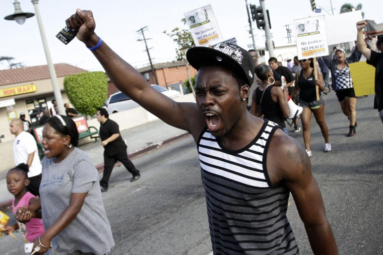 A man shouts during a protest march against the acquittal of George Zimmerman in the Trayvon Martin trial, in Los Angeles, California July 14, 2013. (Jonathan Alcorn/Reuters)