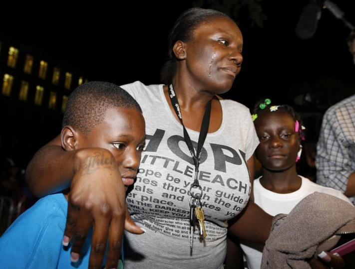 Darssie Jackson (C) reacts with her children Linzey Stafford, 10, (L) and Shauntiana Stafford outside Seminole County Court where George Zimmerman was found not guilty on second-degree murder and manslaughter charges in Sanford, Florida July 13, 2013. (Joe Skipper/Reuters)
