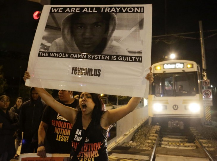 A protester blocks an Expo Line train at the intersection of Exposition and Crenshaw boulevards, following the George Zimmerman verdict in Los Angeles, California, July 13, 2013. (Jason Redmond/Reuters)