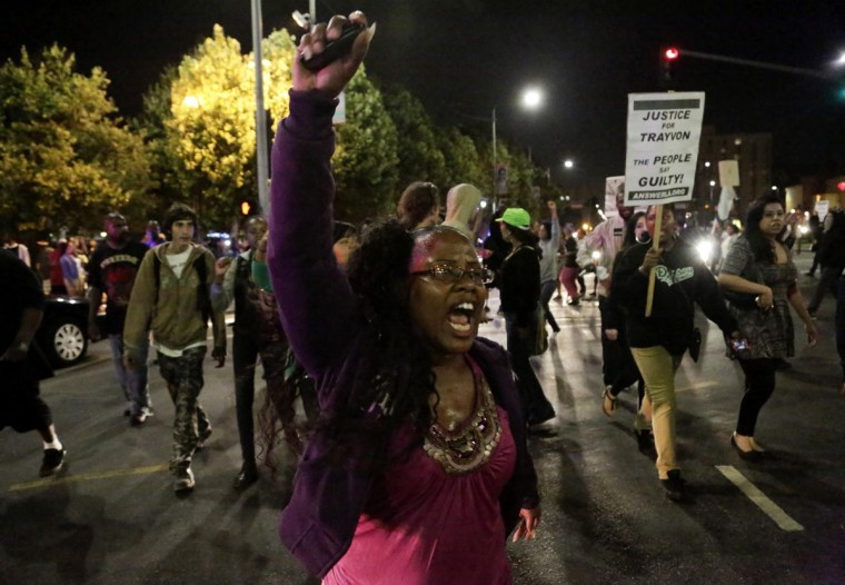 A protester marches with other protesters in the Leimert Park area of Los Angeles following the George Zimmerman verdict in Los Angeles, California, July 13, 2013. (Jason Redmond /Reuters)