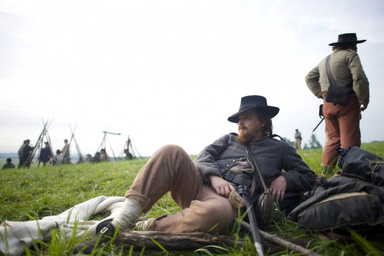 Geoff Roecker, from Brooklyn, New York City, playing a member of the Constitution Guard, lounges in camp the morning of the final day of the Blue Gray Alliance reenactment during events marking the 150th anniversary of the Battle of Gettysburg, in Gettysburg, Pennsylvania June 30, 2013. (Mark Makela/Reuters)