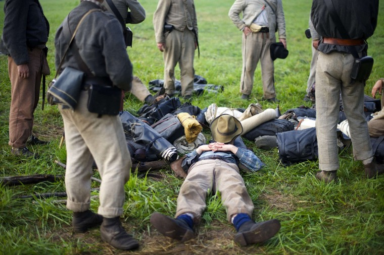 Sean Pridgeon, playing a member of the Constitution Guard, sleeps in camp the morning of the final day of the Blue Gray Alliance reenactment during events marking the 150th anniversary of the Battle of Gettysburg, in Gettysburg, Pennsylvania June 30, 2013. (Mark Makela/Reuters)