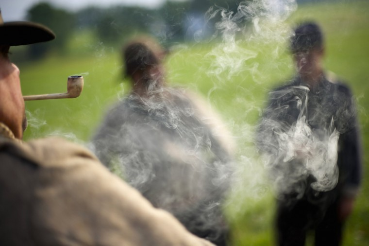 Actors playing Confederate soldiers smoke pipes on the morning of the final day of the Blue Gray Alliance reenactment during events marking the 150th anniversary of the Battle of Gettysburg, in Gettysburg, Pennsylvania June 30, 2013. (Mark Makela/Reuters)