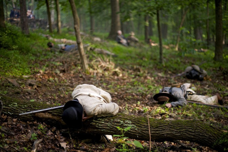 """Actors playing Confederate and Union troops lay """"dead"""" after a reenactment of The Battle of Little Roundtop during the Blue Gray Alliance events marking the 150th anniversary of the Battle of Gettysburg, in Gettysburg, Pennsylvania June 30, 2013. (Mark Makela/Reuters)"""