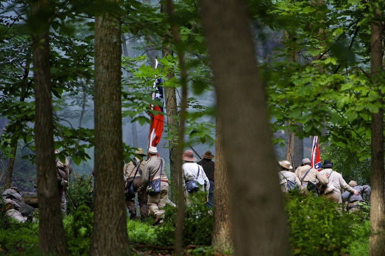 Actors playing Confederate troops charge up a hill towards Union forces during a reenactment of The Battle of Little Roundtop during the Blue Gray Alliance events marking the 150th anniversary of the Battle of Gettysburg, in Gettysburg, Pennsylvania June 30, 2013. (Mark Makela/Reuters)