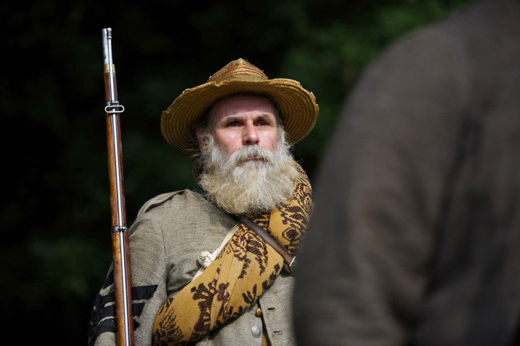An actor playing a Confederate soldier marches before waging a reenactment of The Battle of Little Roundtop during the Blue Gray Alliance events marking the 150th anniversary of the Battle of Gettysburg, in Gettysburg, Pennsylvania June 30, 2013. (Mark Makela/Reuters)