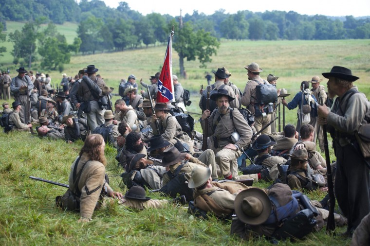 Actors playing Confederate soldiers congregate at a wood's edge awaiting orders to charge during a reenactment of The Battle of Little Roundtop during the Blue Gray Alliance events marking the 150th anniversary of the Battle of Gettysburg, in Gettysburg, Pennsylvania June 30, 2013. (Mark Makela/Reuters)