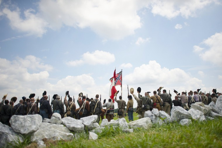 Actors playing Confederate troops raise their hats in celebration after the Pickett's Charge reenactment at the finale of the Blue Gray Alliance events marking the 150th anniversary of the Battle of Gettysburg, in Gettysburg, Pennsylvania June 30, 2013. (Mark Makela/Reuters)