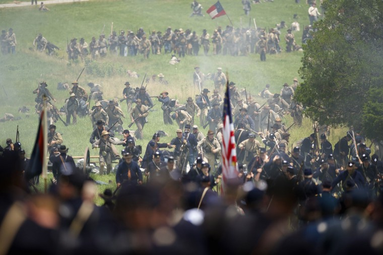 Actors playing Federal and Confederate troops reenact Pickett's Charge at the finale of the Blue Gray Alliance, during events marking the 150th anniversary of the Battle of Gettysburg, in Gettysburg, Pennsylvania June 30, 2013. (Mark Makela/Reuters)