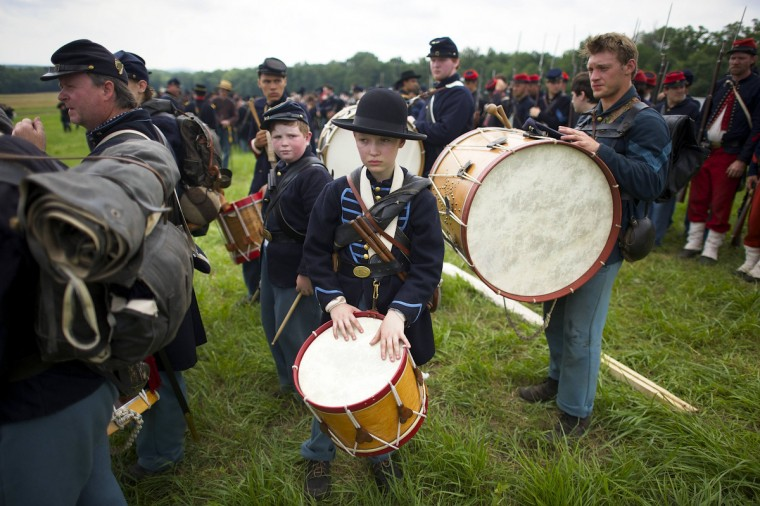 Union volunteer drummer boys await the charge to begin Pickett's Charge at the finale of the Blue Gray Alliance reenactment during events marking the 150th anniversary of the Battle of Gettysburg, in Gettysburg, Pennsylvania June 30, 2013. (Mark Makela/Reuters)