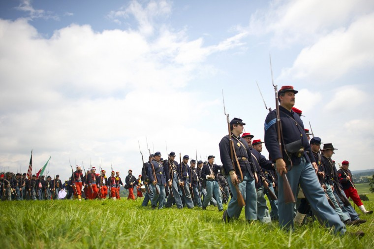 Union volunteers march in before Pickett's Charge at the finale of the Blue Gray Alliance reenactment during events marking the 150th anniversary of the Battle of Gettysburg, in Gettysburg, Pennsylvania June 30, 2013. (Mark Makela/Reuters)
