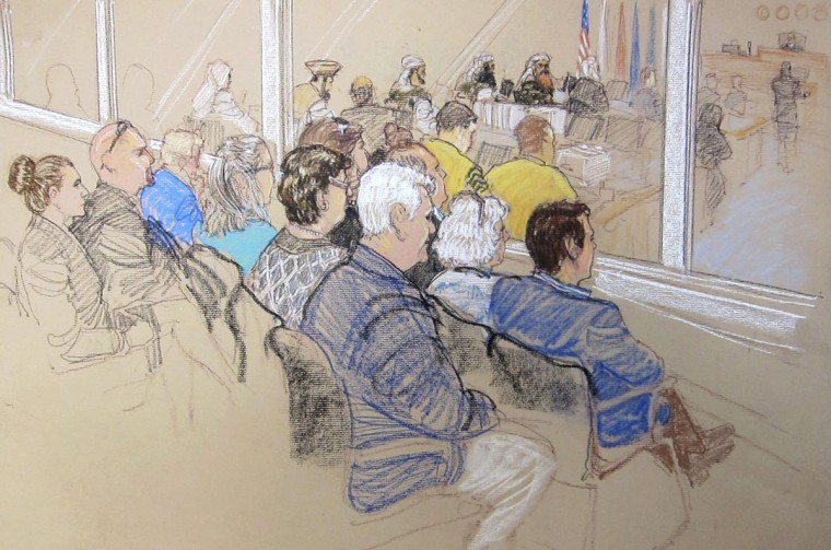 Victim Family Members and Office of Military Commissions staff watch pretrial hearings for the alleged conspirators in the 9/11 attacks in this Pentagon-approved court sketch from Guantanamo Bay, Cuba January 28, 2013. (Back row) OMC Patricia Moss, OMC Domini McDonald. (Second row back to front): Debra Strickland, Phyllis Rodrigues, Joyce Woods, John Woods. (Front row back to front): Loreen Sellitto, Matt Sellitto, Anne Gabriel, and Christopher Gabriel. (Janet Hamlim/Reuters)