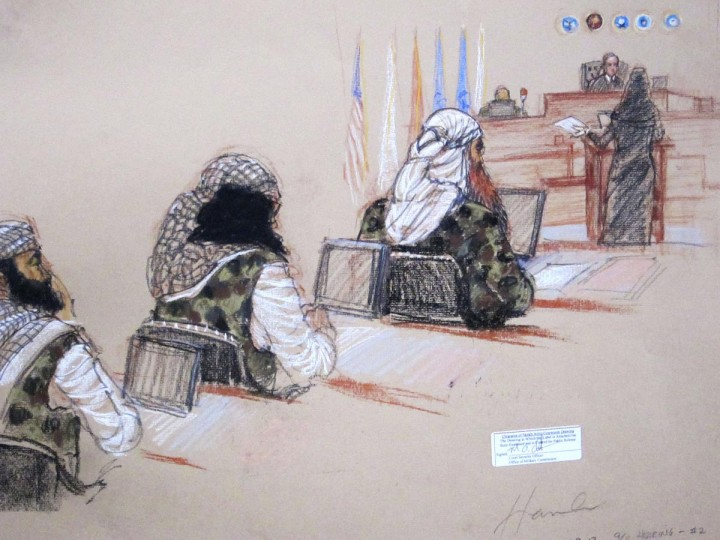 (L-R) Ramzi, Walid bin Attash and Khalid Sheikh Mohammad, three of the alleged conspirators in the 9/11 attacks, attend court dressed in camouflage during hearings in Guantanamo Bay, Cuba January 28, 2013 in this Pentagon-approved court sketch. Defense lawyer Cheryl Bormann, in hijab, stands at the podium before presiding judge Army Colonel James Pohl. (Janet Hamlin/Reuters)