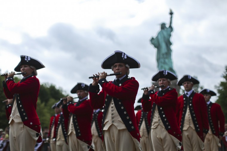 The 3d U.S. Infantry, traditionally known as 'The Old Guard', perform during a ceremony to reopen the Statue of Liberty and Liberty Island to the public in New York July 4, 2013. Under steamy summer skies, tourists in New York flocked to ferries headed for the Statue of Liberty, re-opening with an Independence Day ceremony after closing in October as Superstorm Sandy approached. (Eduardo Munoz/Reuters)