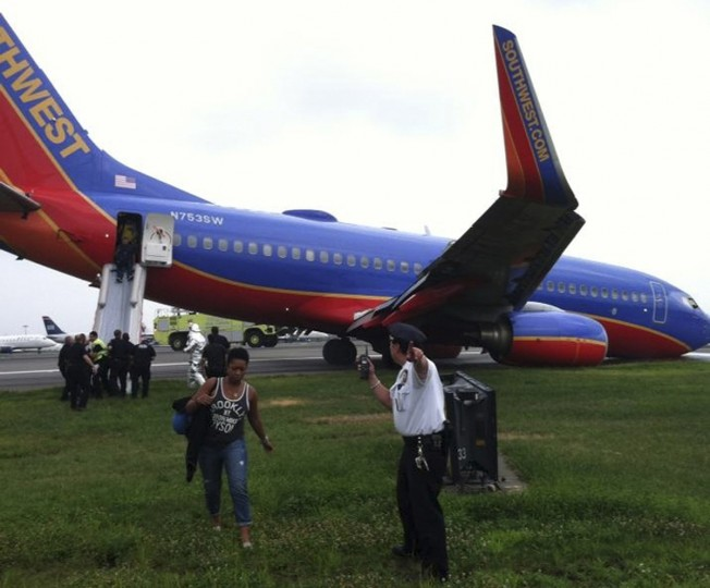 A Southwest Airlines plane sits on the tarmac as passengers disembark at LaGuardia airport in New York in this photo courtesy of @mattjfriedman and Frank Ferramosca. The Southwest Airlines plane flying from Nashville to New York City landed without its nose gear at LaGuardia airport on Monday but no one was hurt, the Federal Aviation Administration (FAA) said. (@mattjfriedman and Frank Ferramosca/via Reuters)