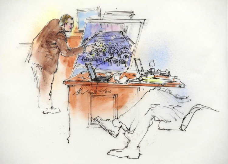 Aurora Police Detective Matthew Ingui is pictured in a courtroom sketch pointing out victims' locations in the movie theater while testifying in Centennial, Colorado January 7, 2013 during a court appearance of James Holmes, the accused shooter in the July 20, 2012 theater shootings. Attorneys are meeting Monday for a preliminary hearing at which prosecutors will lay out their evidence so that Arapahoe County District Judge William Sylvester may decide if there is a basis for trying Holmes. (Bill Robles/Reuters)