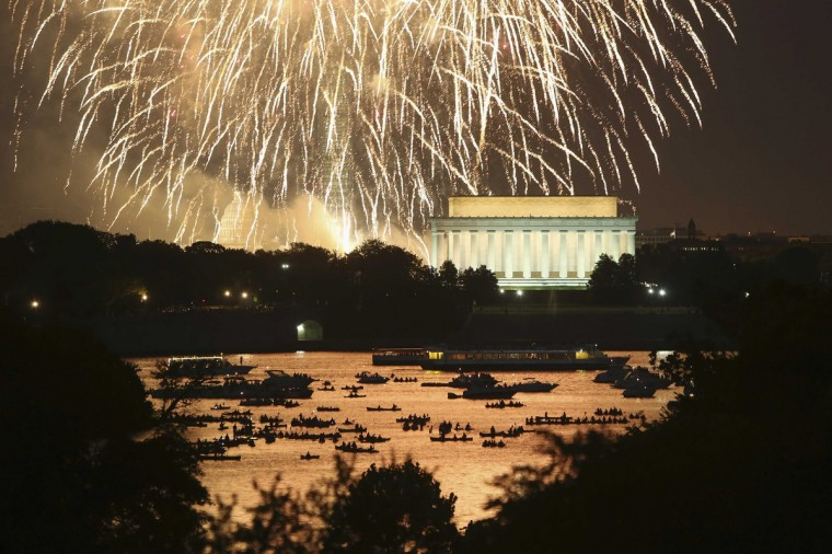 People watch from boats on the Potomac River as Independence Day fireworks light the sky over Washington, July 4, 2013. The iconic Washington skyline of the U.S. Capitol, Washington Monument and Lincoln Memorial serve as a backdrop for the U.S. national birthday celebration each year. (Jonathan Ernst/Reuters)
