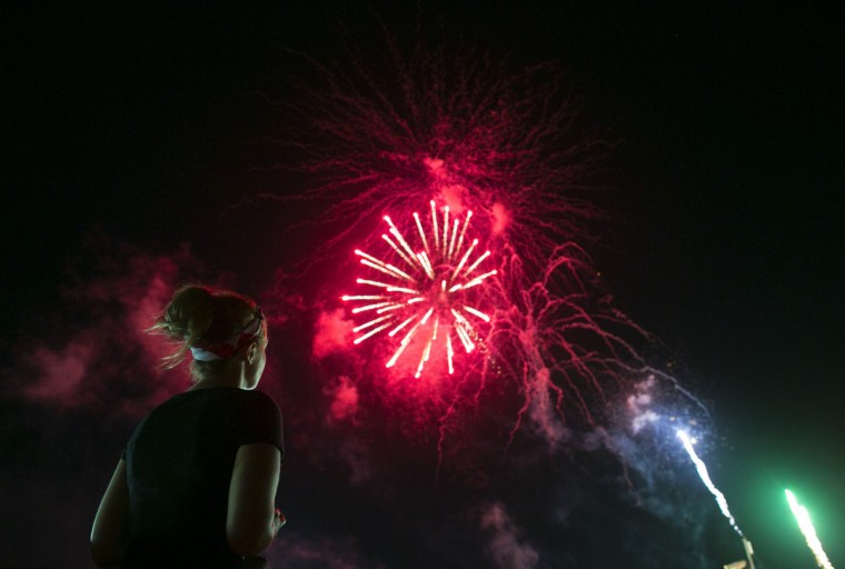 A woman watches the fireworks for Independence Day in Seaside Heights, New Jersey. (Eric Thayer/Reuters)