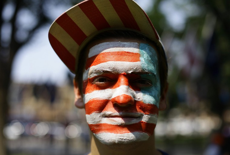 A man with the American flag painted on his face poses for a portrait as he celebrates the Fourth of July Independence Day celebrations in Prescott, Arizona. (Joshua Lott/Reuters)