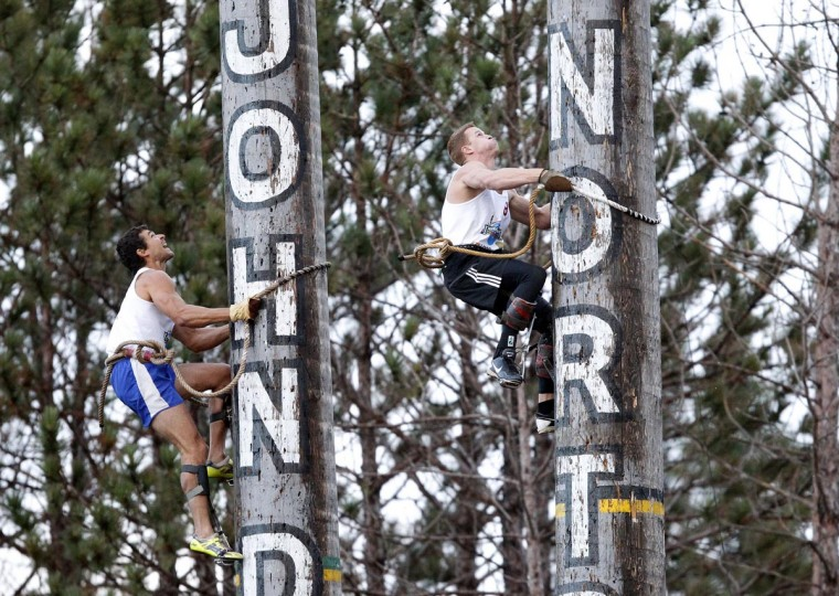 Stirling Hart (R), from British Columbia, competes against Brian Bartow (L) in the 90 foot open climb event during the Lumberjack World Championships in Hayward, Wisconsin July 27, 2013. Hart set a new world record in the climb. Over 100 competitors from around the world are competing in 21 events ranging from sawing and chopping to log rolling. (Eric Miller/ReuterS)