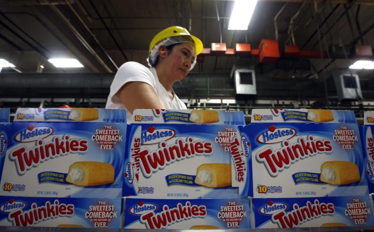 A worker boxes up Twinkies at a plant in Schiller Park, Illinois, July 15, 2013. The Twinkie returned to production after the Hostess's snack cake brand was purchased earlier this year by buyout firms Apollo Global Management and Metropoulos & Co. (Jim Young/Reuters)