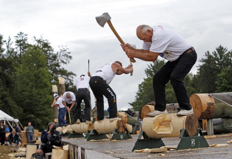 Gus Carlson, 74, competes in the Masters underhand chop event during the Lumberjack World Championships in Hayward, Wisconsin July 27, 2013. Over 100 competitors from around the world are competing in 21 events ranging from sawing and chopping to log rolling. (Eric Miller/Reuters)