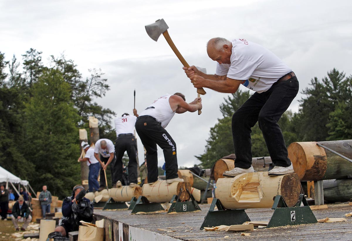 July 28 Photo Brief: Lumberjack World Championships, The Sumo Run, election in Cambodia