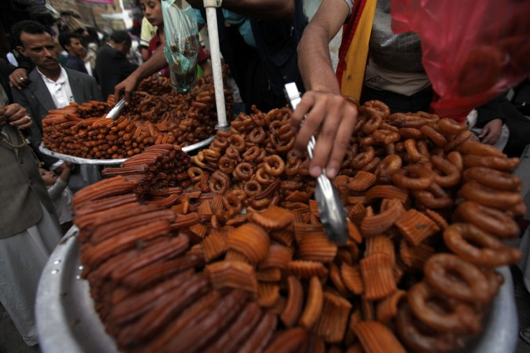 People sell sweets during the Muslim holy fasting month of Ramadan in Sanaa, July 10, 2013. Muslims in Yemen begin fasting on Wednesday. (Mohamed al-Sayaghi/Reuters)