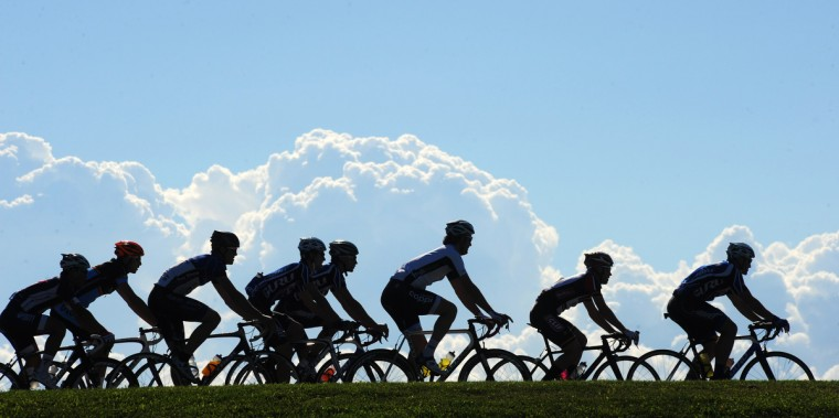 Riders roll out under a neutral start at the beginning of the CAT 3 group of the Road Warrior 50 road race. (Jerry Jackson/Baltimore Sun)