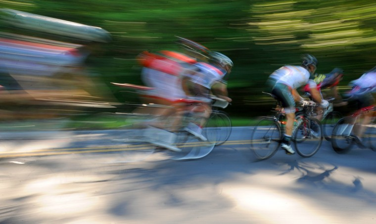 Cyclists are a blur in this slow-shutter speed photo during the Road Warrior 50 road race. (Jerry Jackson/Baltimore Sun)