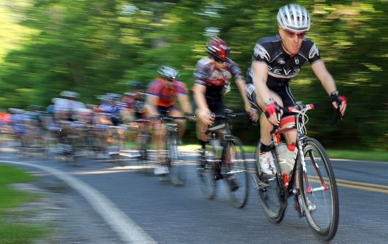 Cyclists fly down Carrs Mill Road during the Road Warrior 50 road race. (Jerry Jackson/Baltimore Sun)