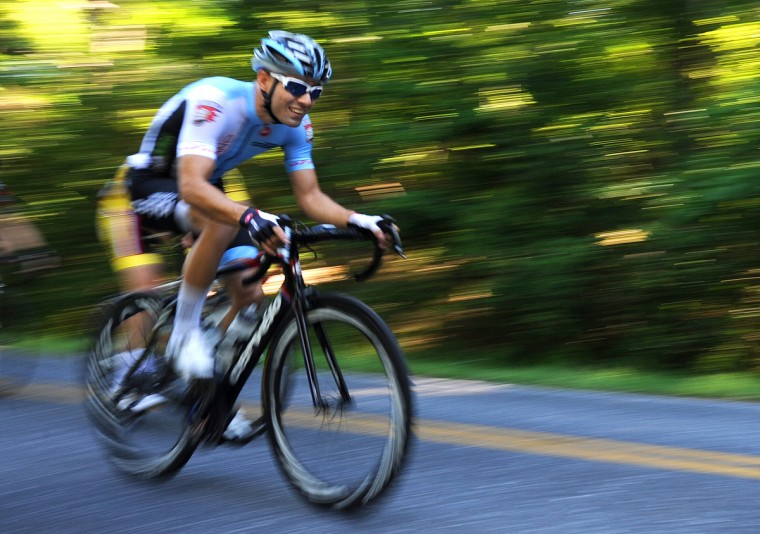 A cyclist flies down Carrs Mill Road during the Road Warrior 50 road race. (Jerry Jackson/Baltimore Sun)
