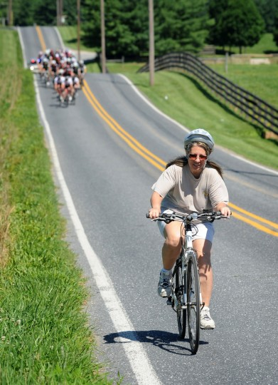 A recreational cyclist hurries to a pullout as the main field of CAT1 racers quickly approaches during the Road Warrior 50 road race. (Jerry Jackson/Baltimore Sun)