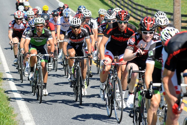 The CAT 1 field works through the rolling hills on Ae Mullinix Road during the Road Warrior 50 road race. (Jerry Jackson/Baltimore Sun)
