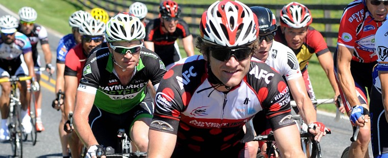 Adam Driscoll of Halethorpe rides in the peloton on Ae Mullinix Road during the Road Warrior 50 road race. (Jerry Jackson/Baltimore Sun)