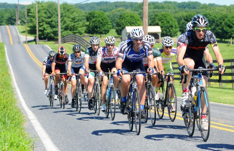 A peloton works through the rolling hills on Ae Mullinix Road during the Road Warrior 50 road race. (Jerry Jackson/Baltimore Sun)