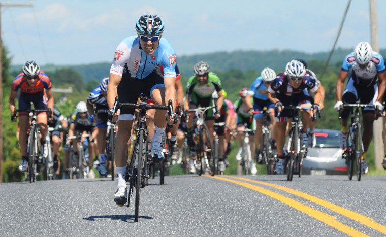 Michael Russo of Arlington, Virginia sprints uphill toward the finish line to win the CAT 4 division of the Road Warrior 50 road race. (Jerry Jackson/Baltimore Sun)