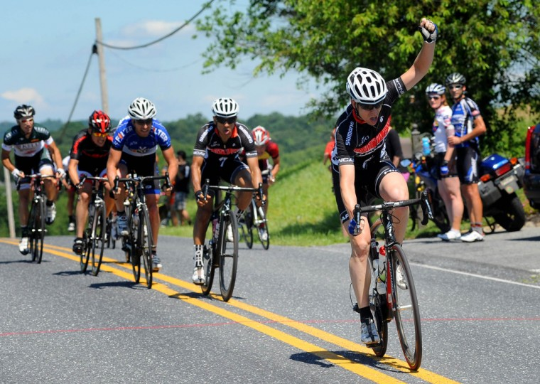 Sean Barrie of Washington, D.C. celebrates as he crosses the finish line to win the CAT 1 division of the Road Warrior 50 road race. (Jerry Jackson/Baltimore Sun)