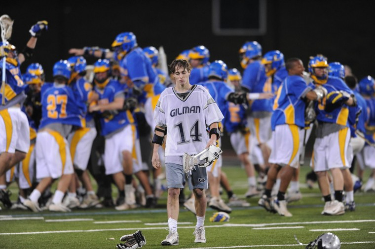 The Gilman boys lacrosse team's bid for an undefeated season in 2008 came to an end at the hands of Loyola, 12-11. Here, Gilman's Greg McBride walks off the field in Towson dejectedly while Loyola celebrates behind him. (Gene Sweeney Jr./Baltimore Sun)