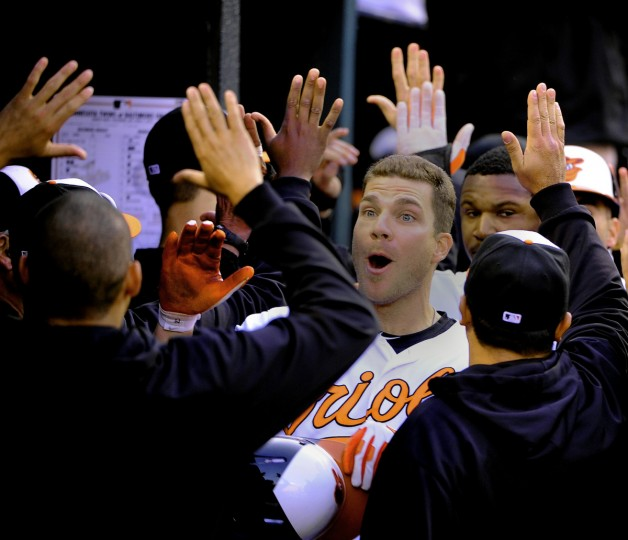 Orioles slugger Chris Davis reacts to his teammates after hitting a grand slam in the 8th inning, giving Baltimore a 9-5 win in their home opener on April, 5 2013. (Gene Sweeney Jr./Baltimore Sun)