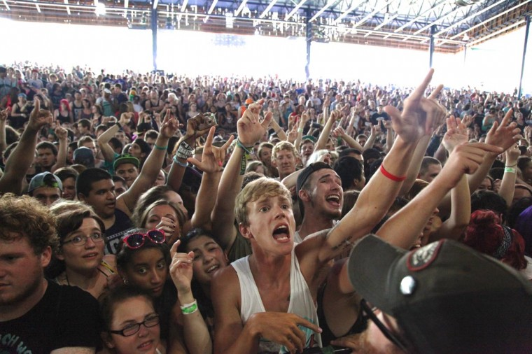 Vans Warped Tour 2013: Fans look on as hardcore band Chiodos performed July 10 at Merriweather Post Pavilion. (Credit: Kaitlin Newman)