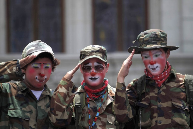 Clowns dressed as soldiers salute during a parade to inaugurate the 5th Annual Clowns' Convention in Guatemala City. (Jorge Dan Lopez/Reuters photo)