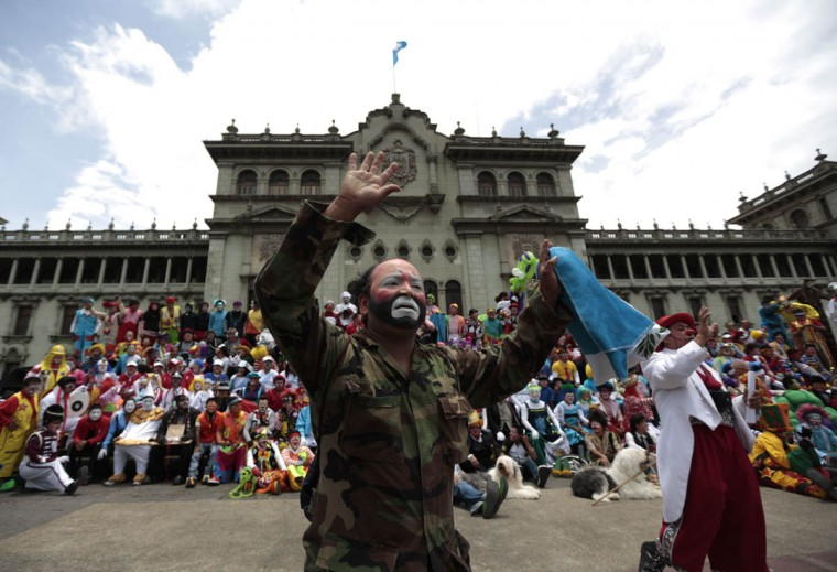 Clowns gather for a group photo after a parade to inaugurate the 5th Annual Clowns' Convention. (Jorge Dan Lopez/Reuters photo)